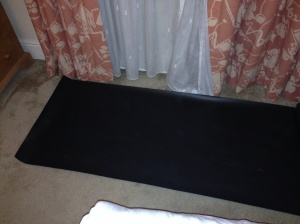 Just about room for my mat between the bed and the window!