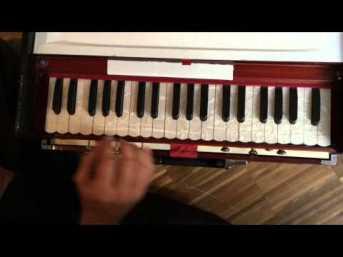 hand-on-harmonium